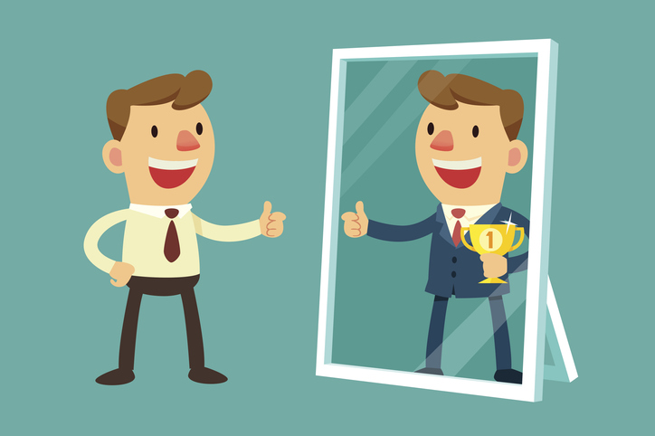 man looking at reflection in mirror with ambition.jpg