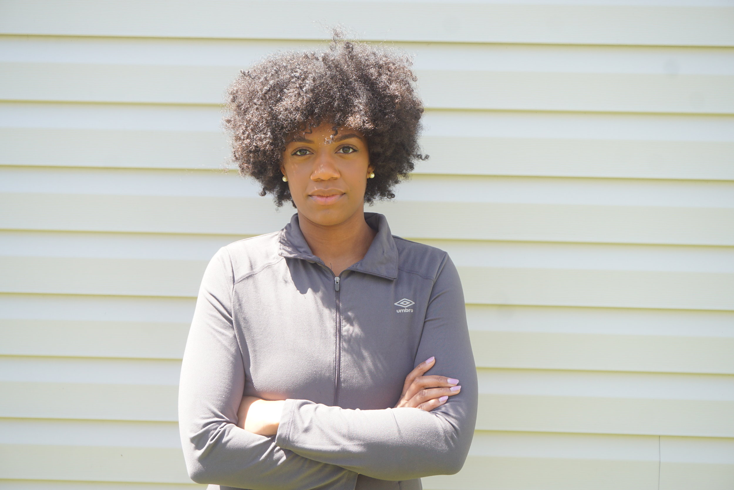 Sun's Out, Fro's Out - My go-to twist out is a three-strand twist out. I like to rock my 'fro after a fresh twist out. You can also wear a headband to pull your hair back a bit and keep it out of your face during runs.