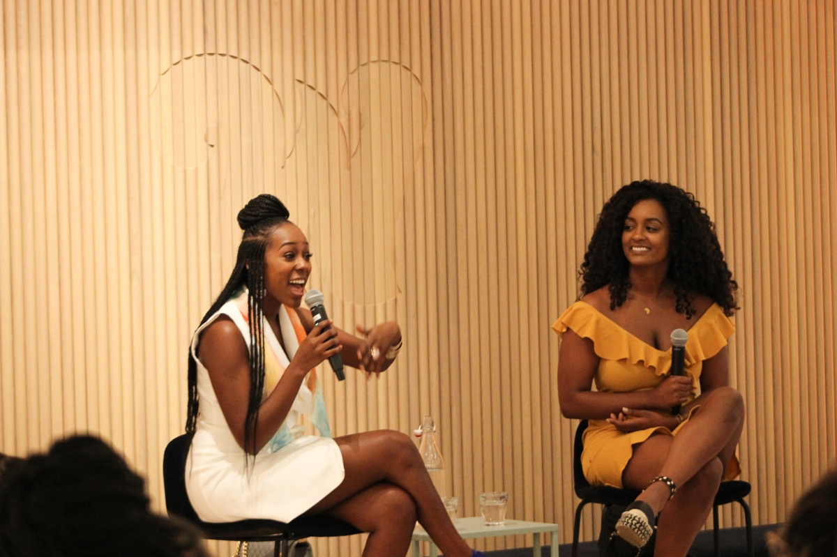 Yene Damtew speaks with an audience member during a discussion on hair and busy lifestyles with Youtube hair and lifestyle blogger Hermela Soloman at The Wing, D.C. on July 24, 2018. Photo: Na'Tasha Jones for RUNGRL.