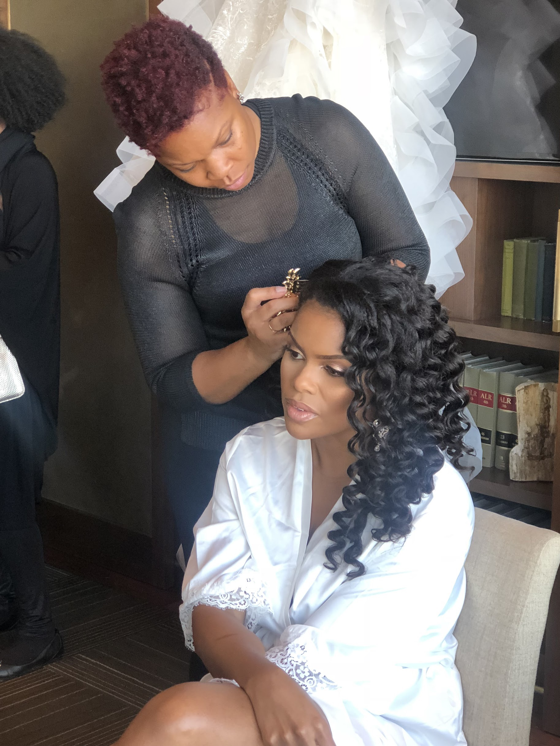 Tanika and a client. Photo provided by Tinika.