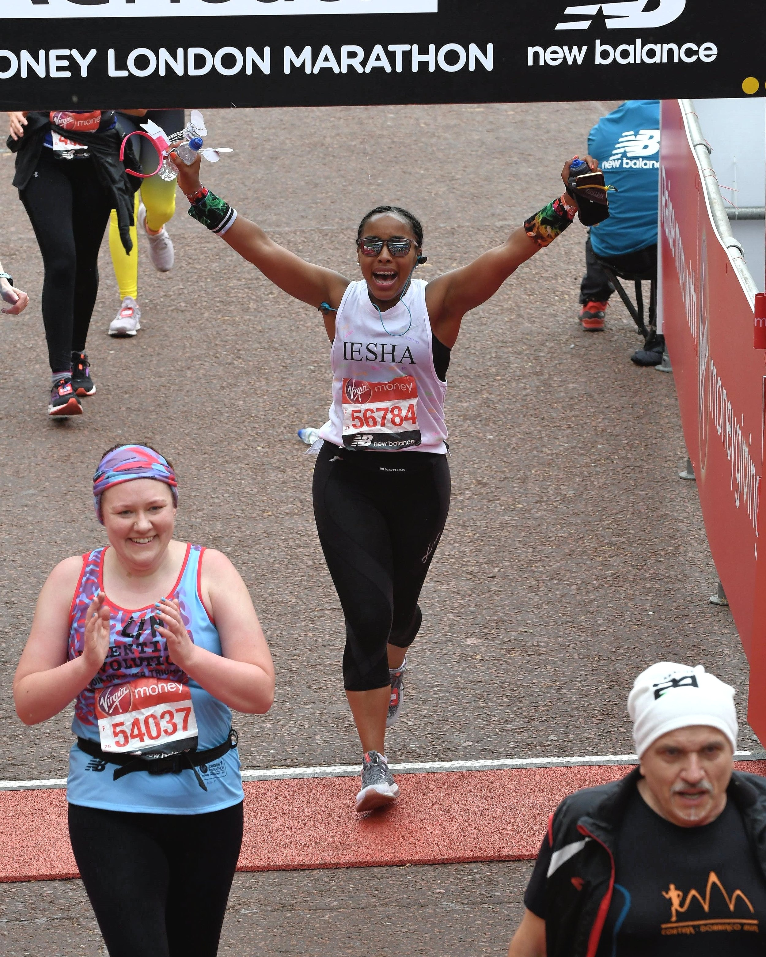 Sprinting across the finish line of the 2019 Virgin Money London Marathon. Photo via Iesha Pankey