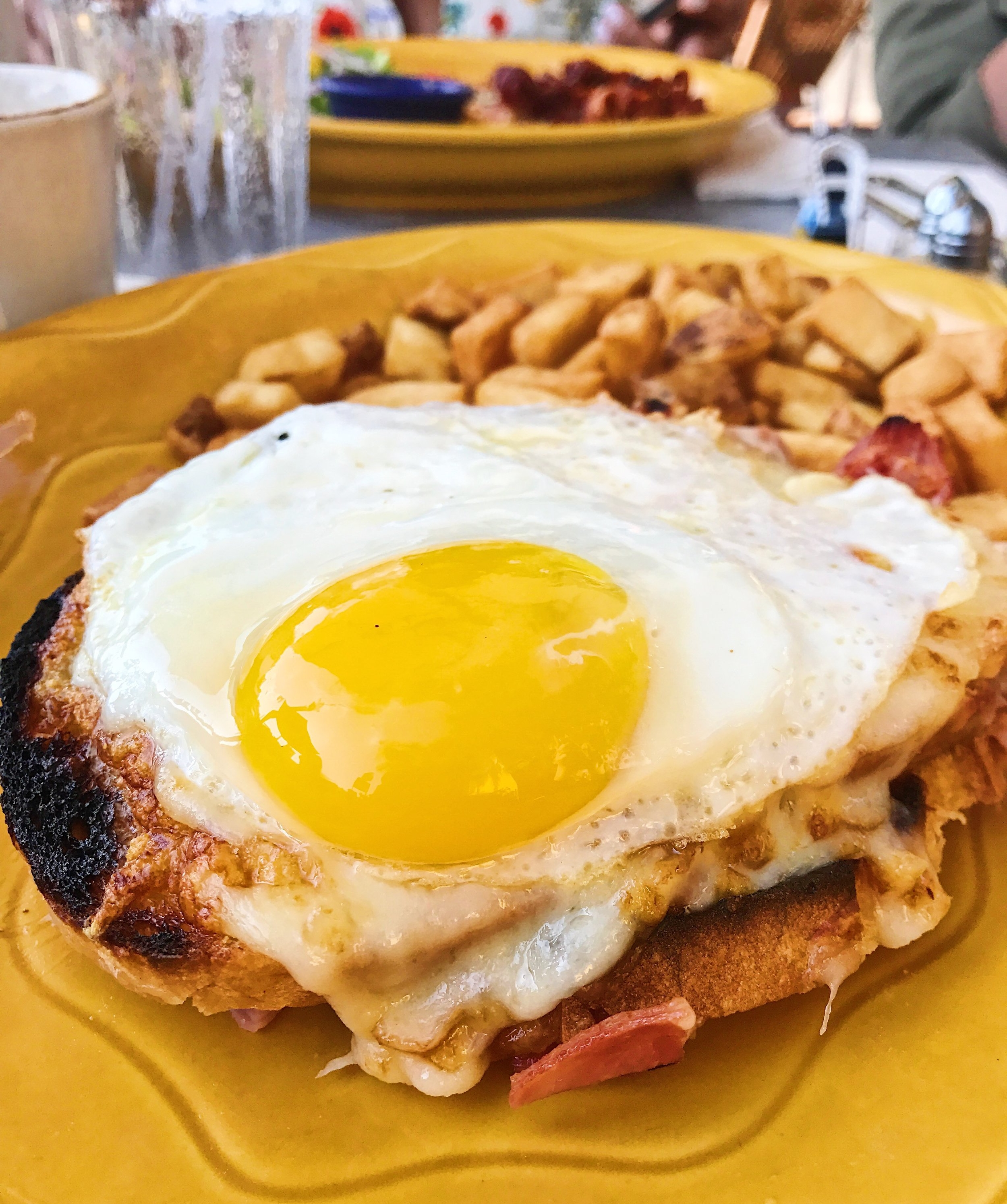 Croque Madame with toasted ham and cheese on bread with a delicious bechamel sauce and an an egg sunny-side-up.