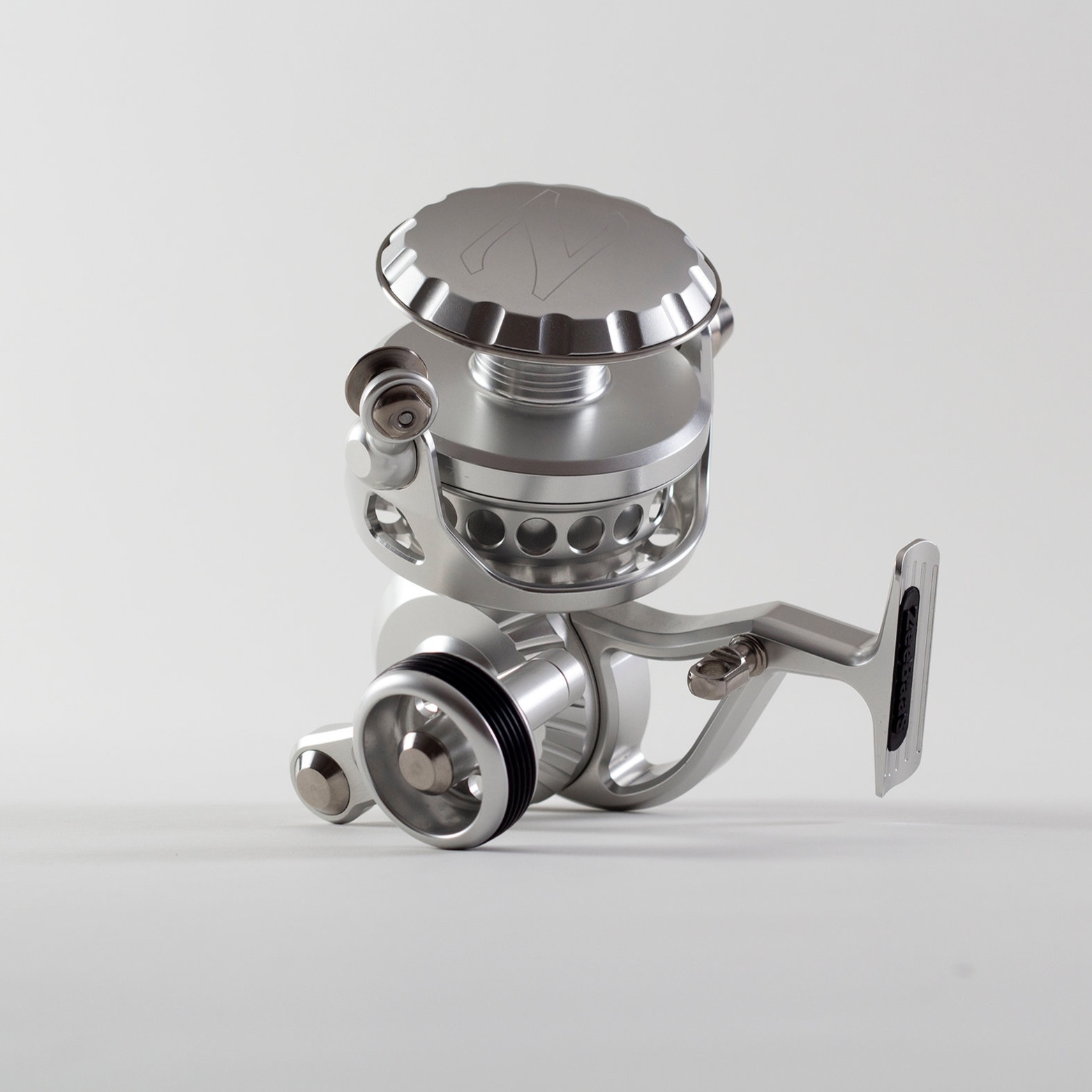"ZeeBaaS ZX-27 - The ZX-27 is our largest that is perfect for the surfcaster who's tossing a long rod from shore, or the off-shore fisherman seeking big-game. Like all of our reels, the ZX-27 is fully sealed and completely waterproof. We offer the ZX-27 in black, silver or a combination of black and silver which we refer to as our tuxedo edition. Custom colors and personal engraving are also available for an additional charges. Contact us for details.Our ZX-27 DeliversSpool Diameter: 2.75""Weight: 22.4 ozGear Ratio: 4.75:1Capacity: Mono: 380/20 - Braid: 500/50Retrieve: 39.5"" per turnMax Drag: 40lbsAble to be self-maintained or factory maintained.Starting at $989.00"