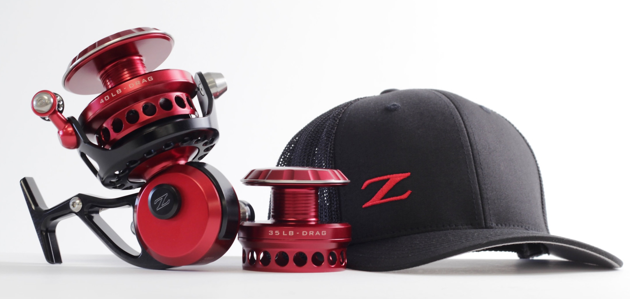 Shown above: Customers request for a Red+Black ZX-27 with custom engraving and interchangeable ZX-25 spool, and Black+Red OCEAN BOSS™ Trucker Hat.