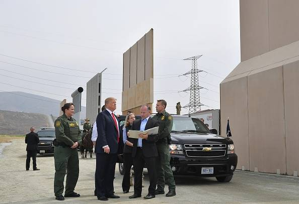 President Donald Trump inspects border wall prototypes in California in 2018. (Getty) AFP Contributor—AFP/Getty Images  By RYAN TEAGUE BECKWITH