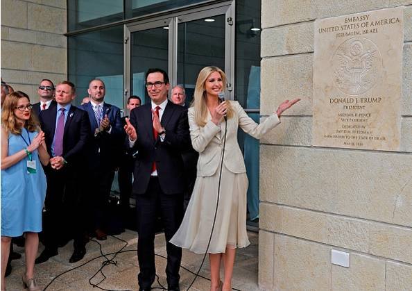 Treasury Secretary Steve Mnuchin claps as US President's daughter Ivanka Trump unveils an inauguration plaque during the opening of the U.S. embassy in Jerusalem on May 14, 2018. (Getty) AFP Contributor—AFP/Getty Images