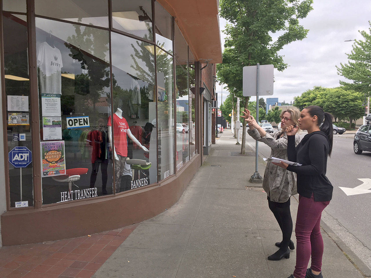 "A consultant working with store owner in downtown Renton. In 2018, Renton hosted a several workshops called ""Creating Stellar Storefronts"" funded through the Economic Development Partnership program. Courtesy of the Port of Seattle  By Evan Pappas"