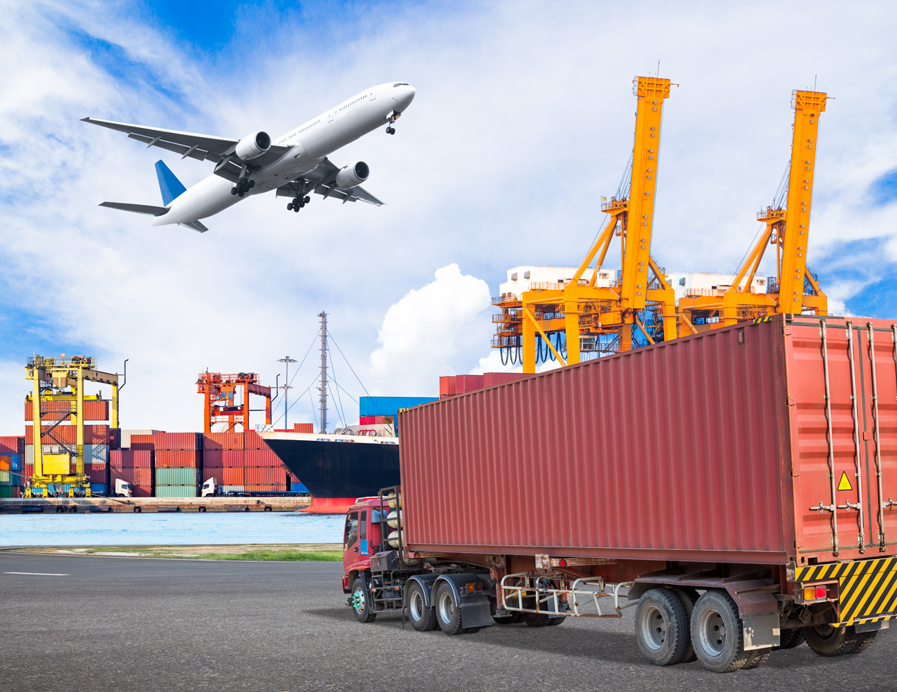 Truck-transport-container-and-cago-plane-flying-above-ship-port-646931962_5472x4219.png
