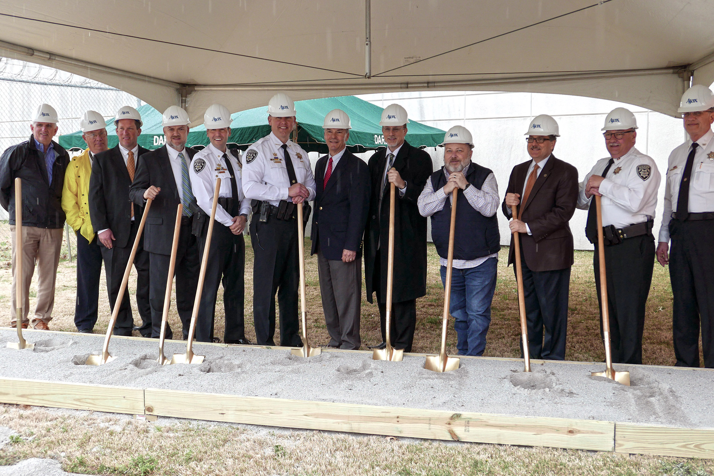 The Sheriff, Members of the Sheriff's Department, County Officials, and Members of the Design and Construction Team gather for the ground breaking