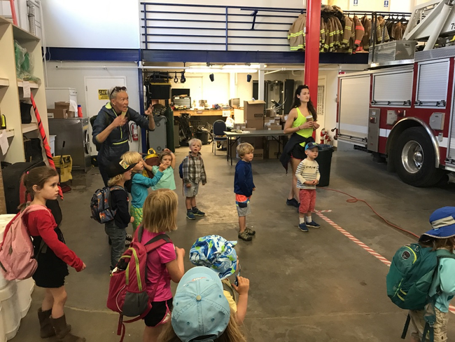 A parent arranged and lead a super fun field trip to the fire station to learn about emergencies!