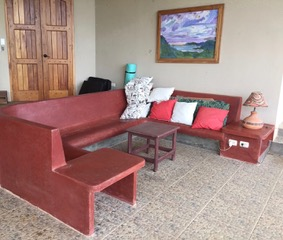 Outside living room, couch made of concrete