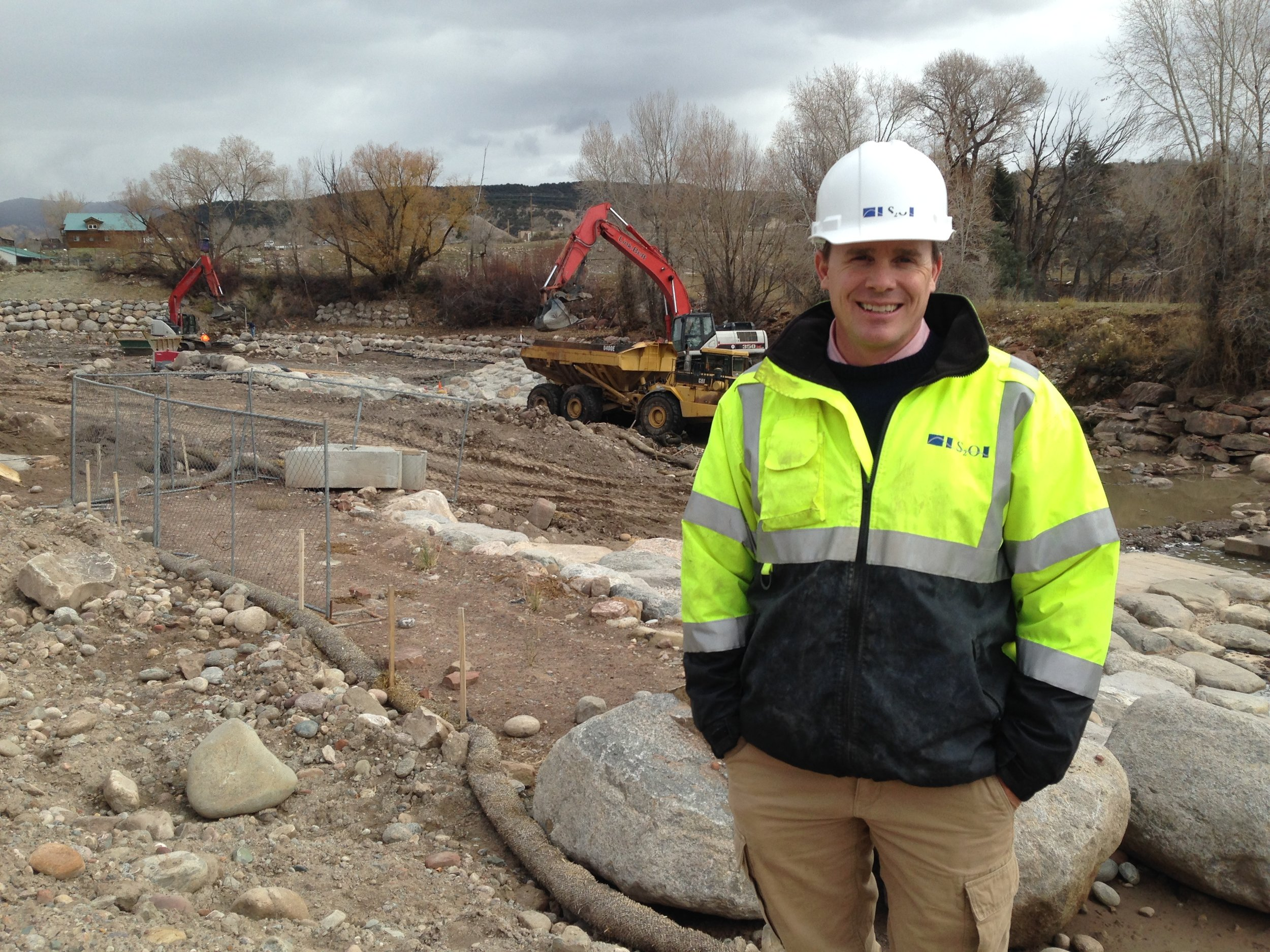 """Scott Shipley of S20 during construction of the Eagle River Whitewater Park. """"We can give them an experience they didn't have before. Just by doing a little bit of manipulation of that river, they can become the Breckenridge of kayaking."""" Eugene Buchanan"""