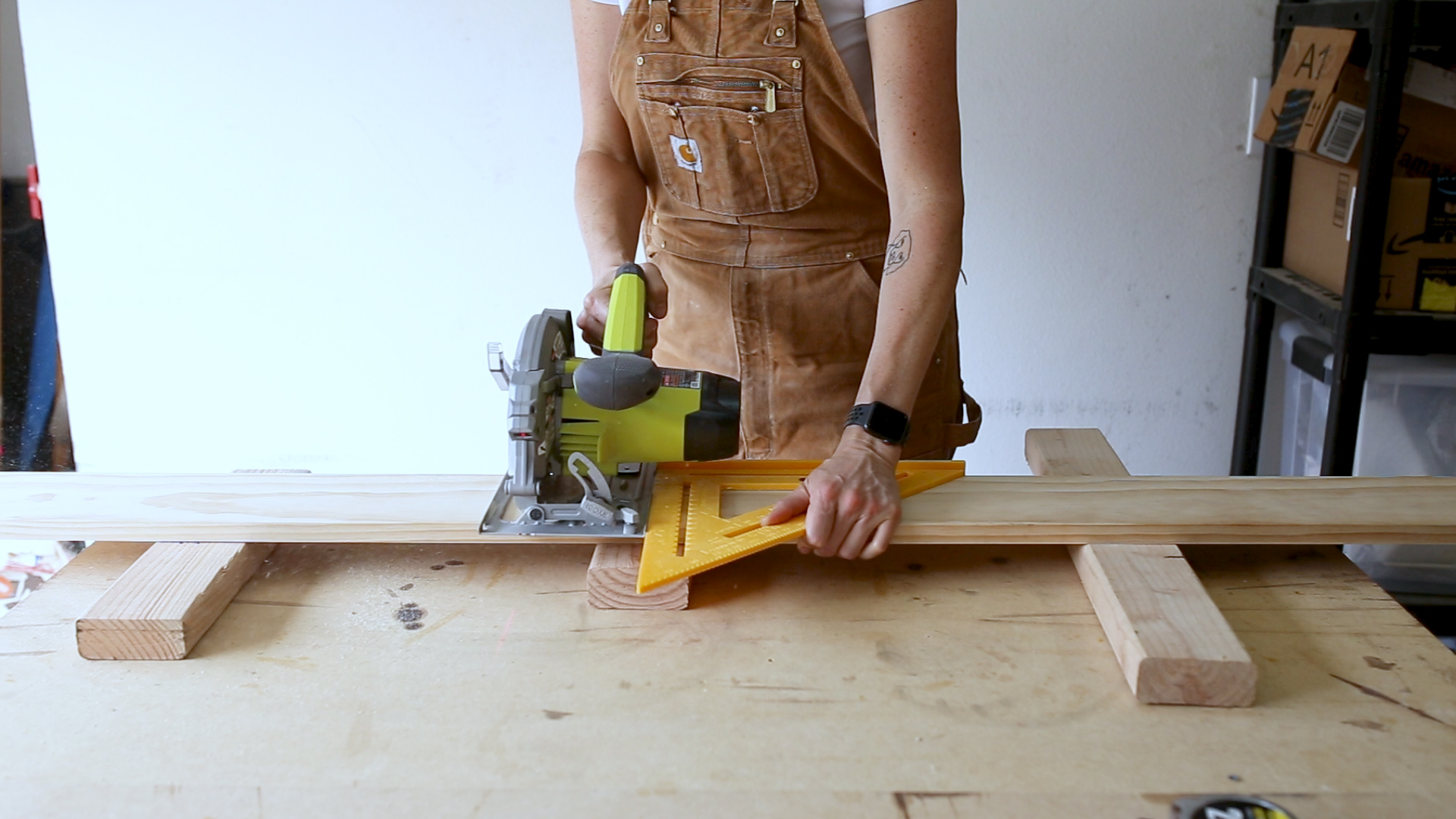 "I used a  Speed Square  as a straight edge and cut two 26"" boards with my  Circular Saw ."