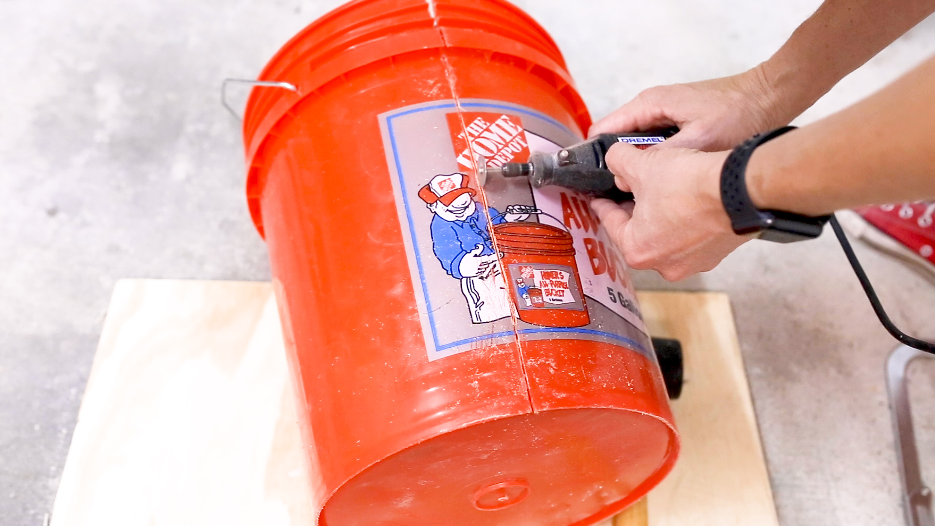 I then carefully made a cut down the side of the bucket with my  Dremel