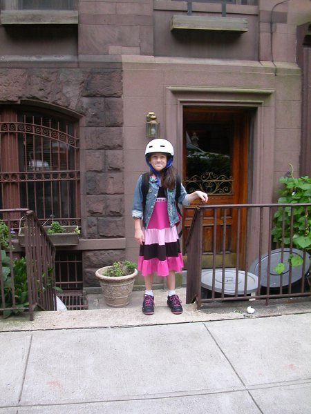 Charlotte outside the 87th street apartment, about to wreak havoc.