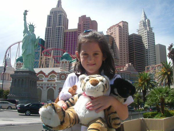 The native New Yorker poses in front of the phoney NYC skyline in Vegas, holding her loot from Circus Circus. We moved to Vegas instead of having another baby.