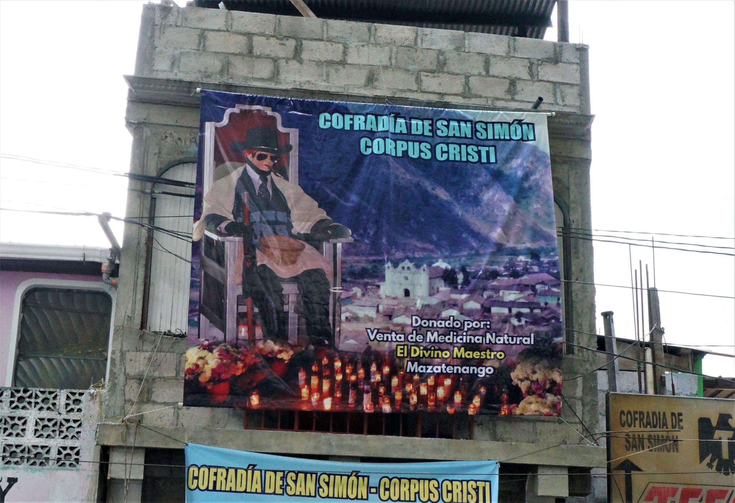 Advertisement above the shrine of San Simon in Zunil, Guatemala