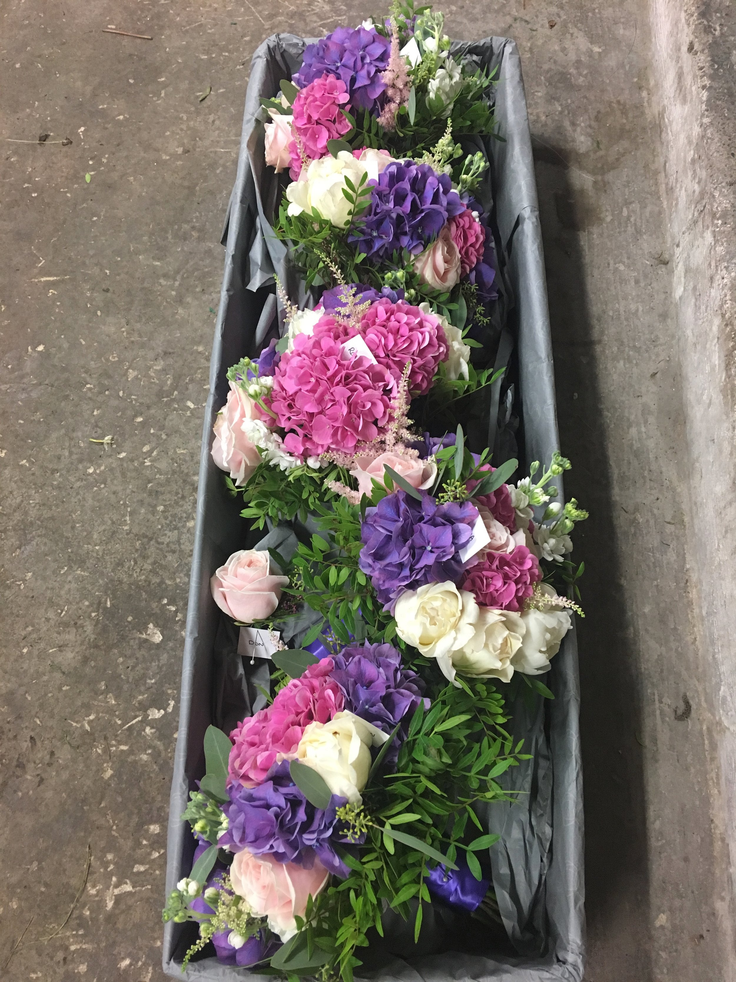 Delivered without water - In cooler months flowers are delivered in boxes without water.