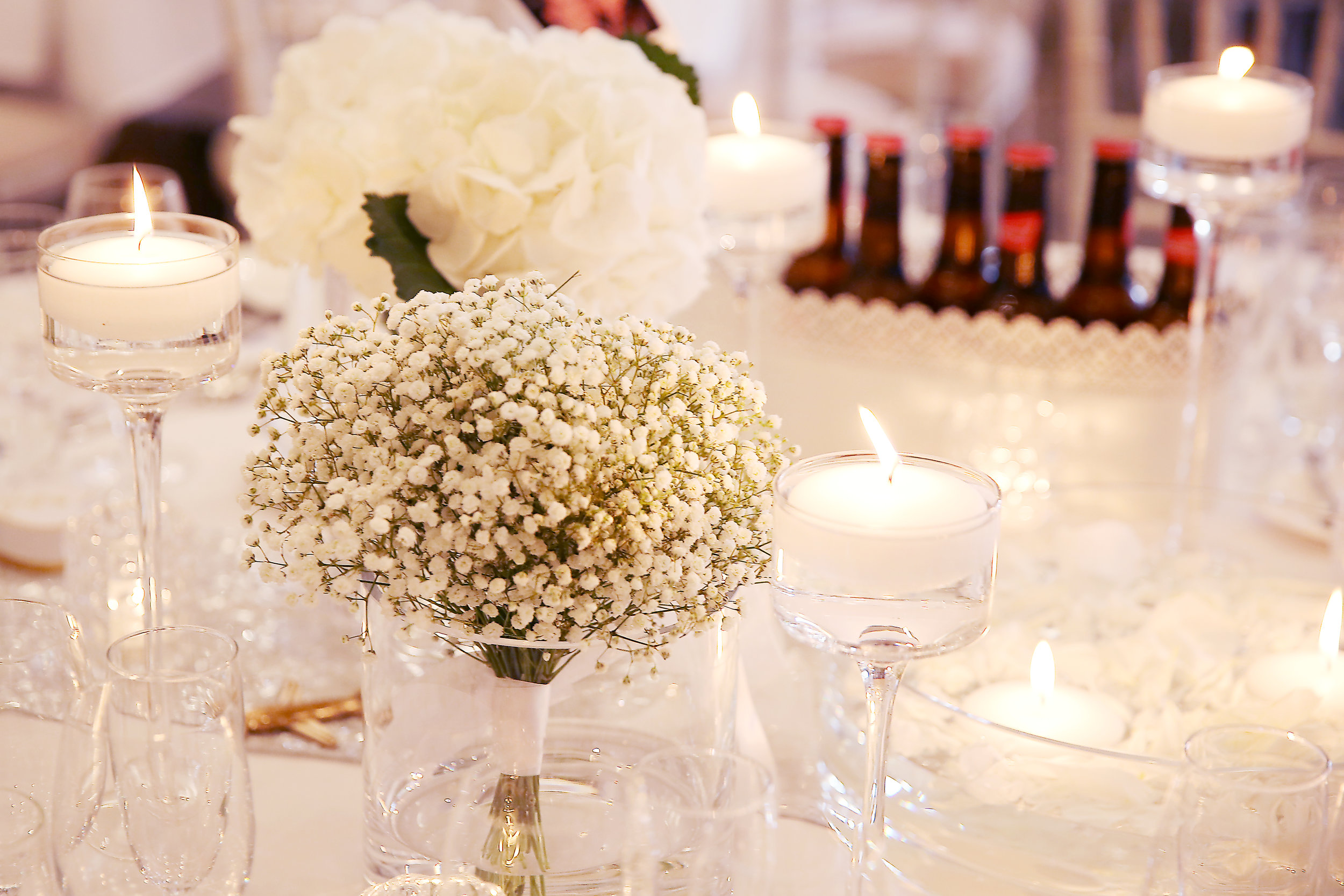 In some cases, where the style and flowers suit, you can use the bouquets on the tables too.