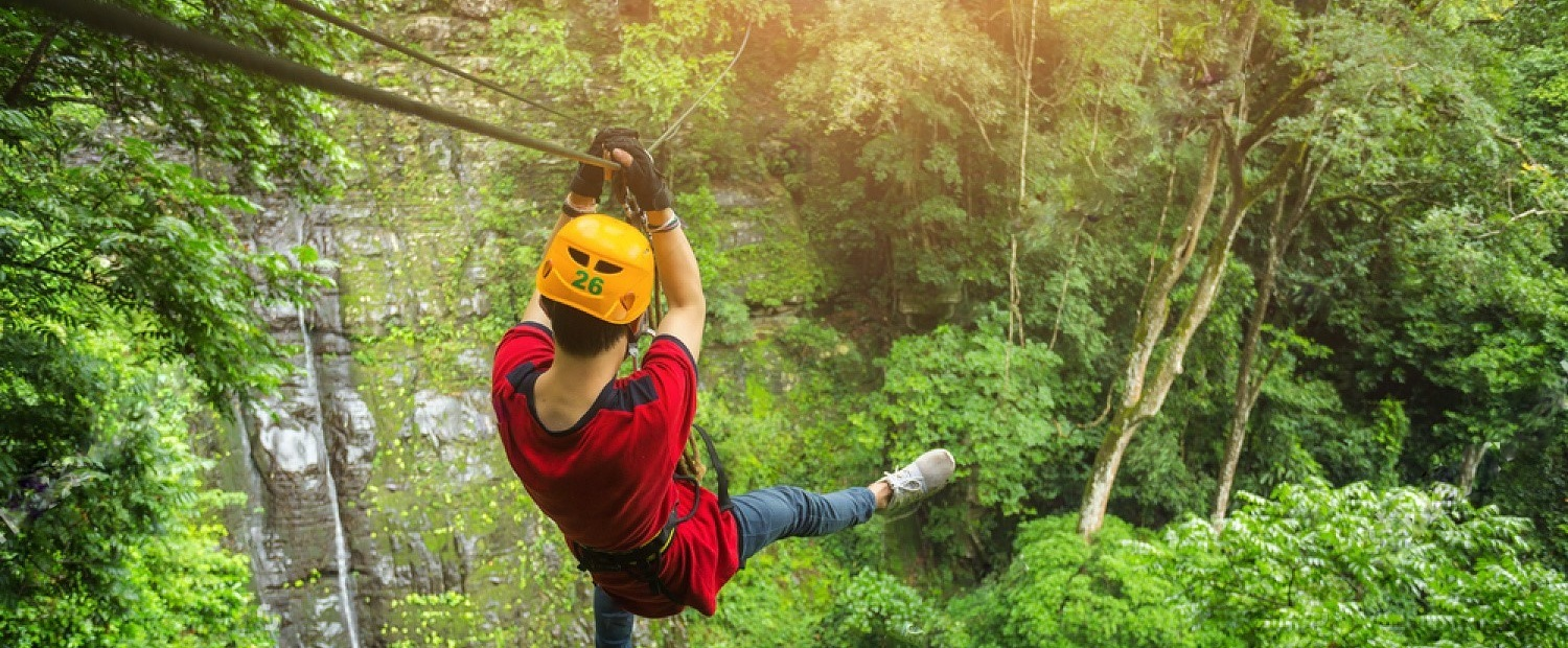 stock-photo-freedom-adult-man-tourist-wearing-casual-clothing-on-zip-line-or-canopy-experience-in-laos-rain-690320167.jpg