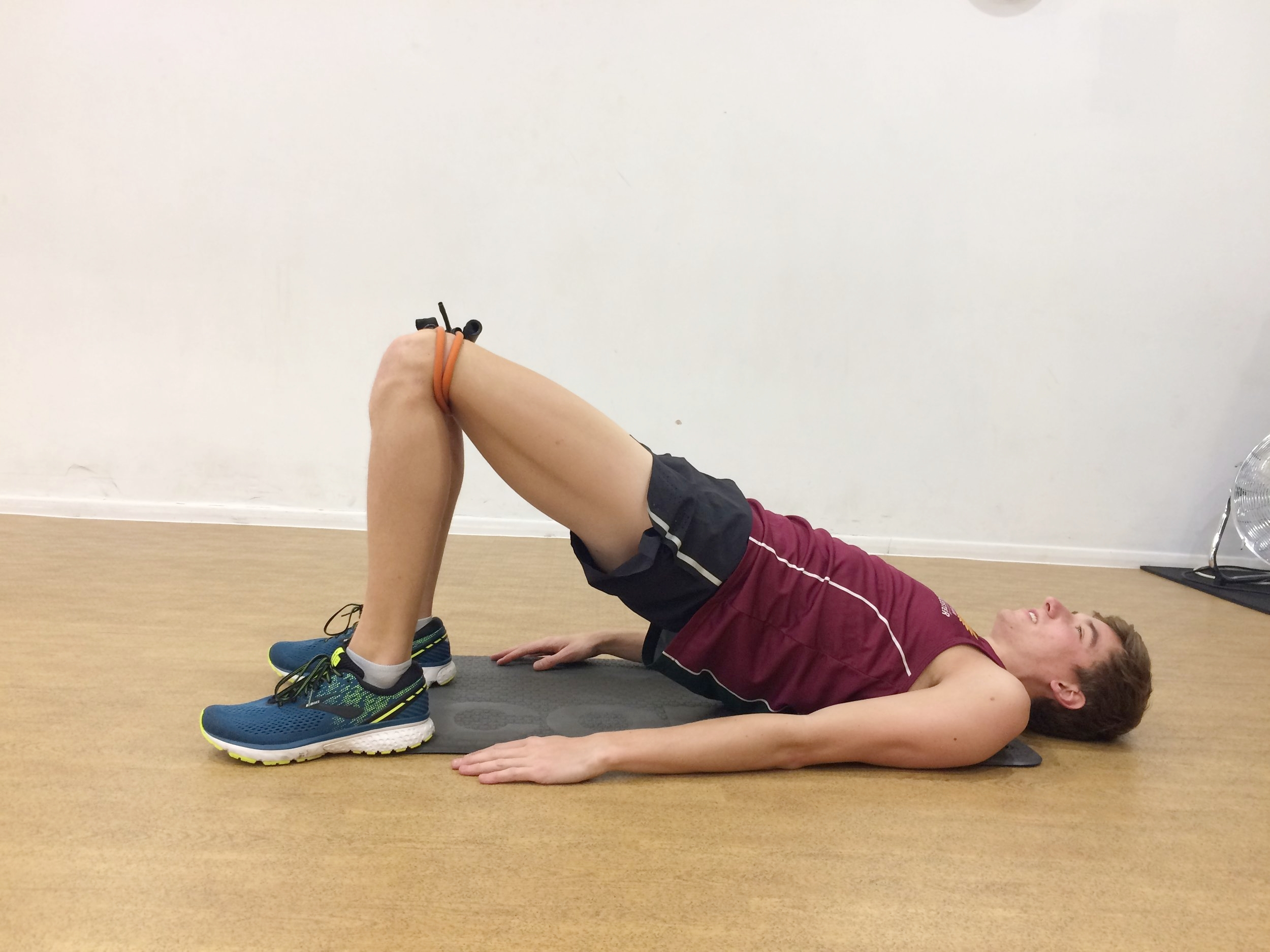 2) Glute bridge   12 reps  Press through the heels. Push hips upward. To increase difficulty use weight on hips / raise one leg of floor