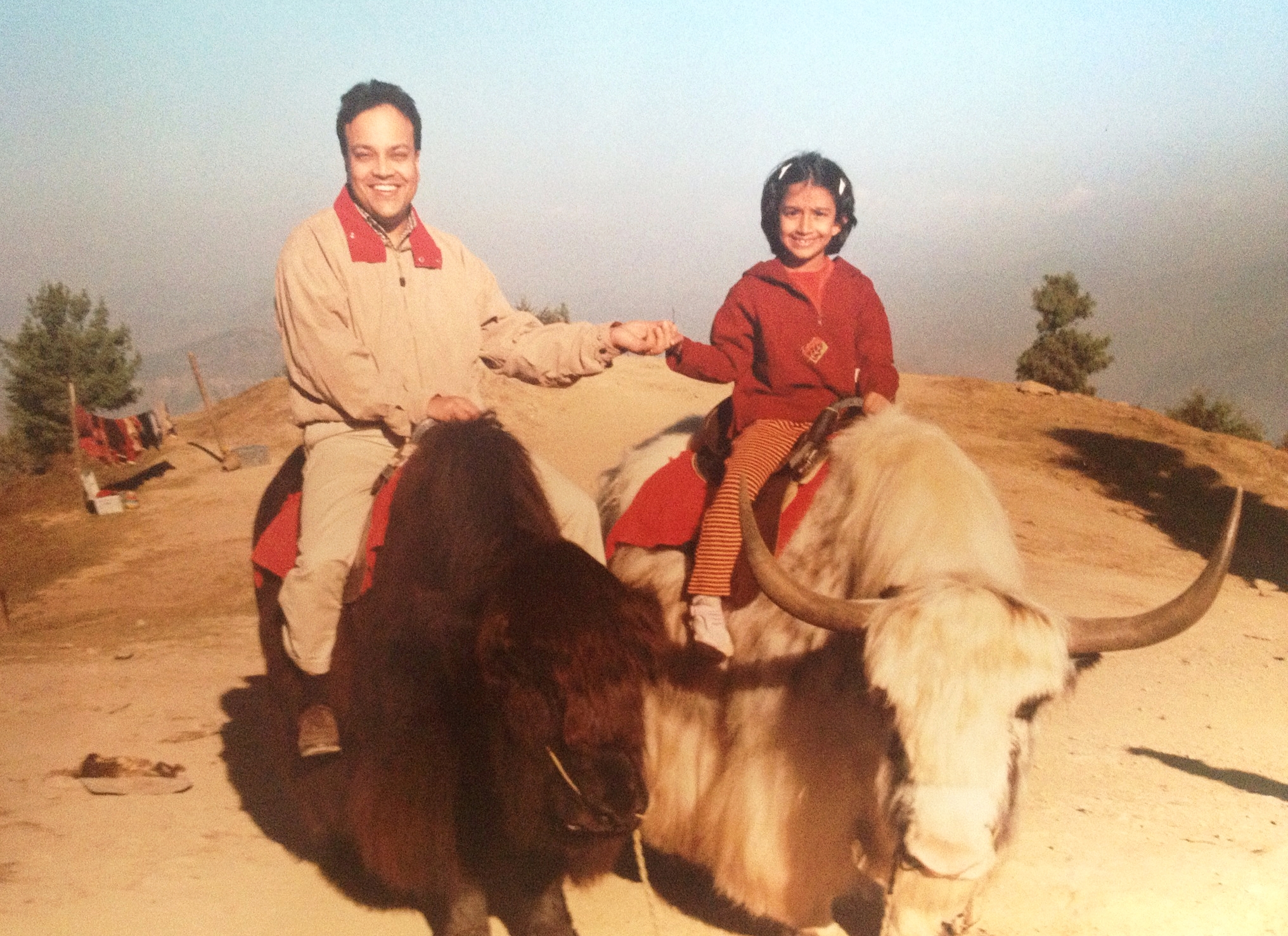 My dad and I riding yaks at the top of a mountain in Shimla, one of the Northern-most parts of India, by the Himalayan foothills.