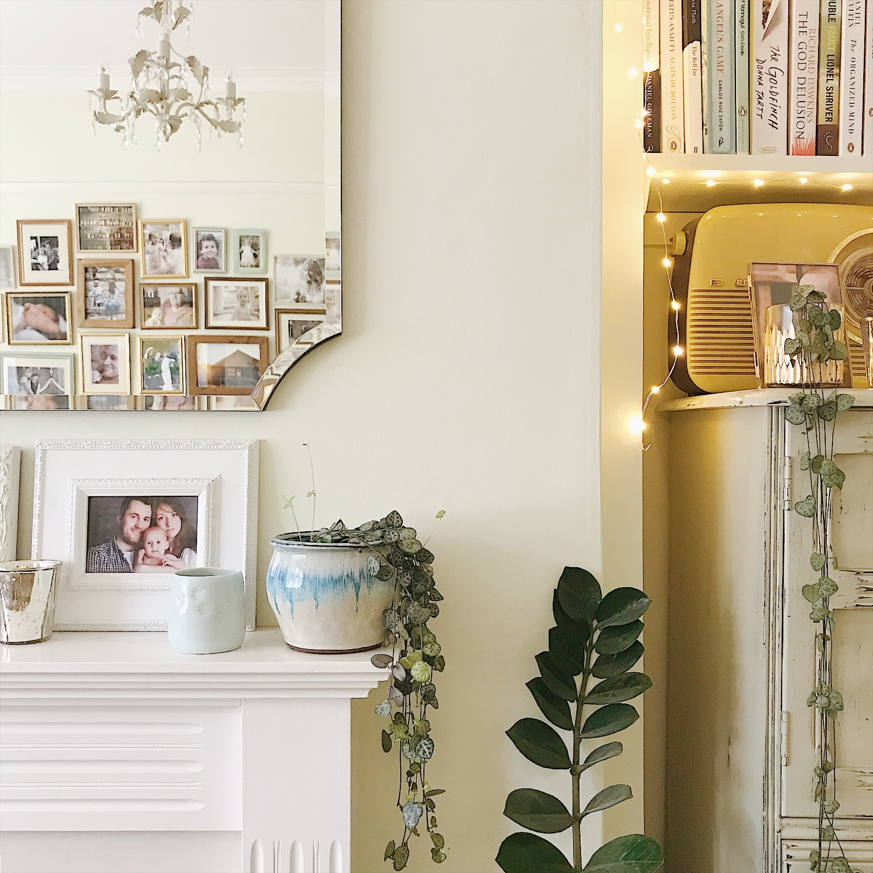 Photos propped against a wall look inviting and allow space for styling in front, and that gallery wall again in the mirror