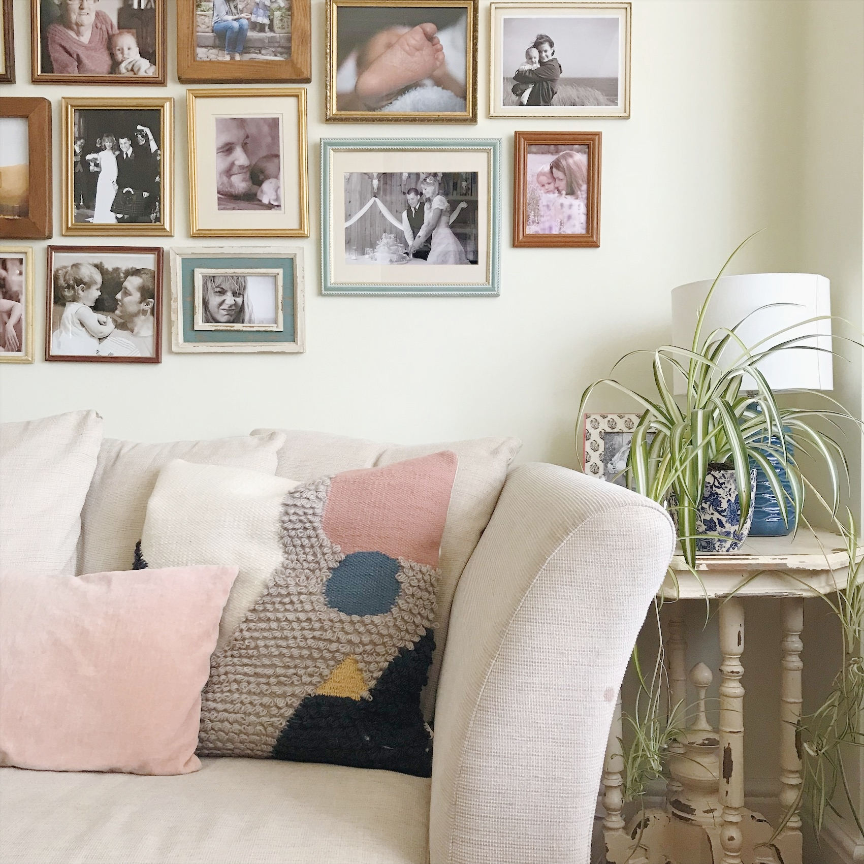 Gallery wall in muted tones and with eclectic charity shop frames