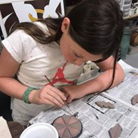 Kid painting glaze.jpg