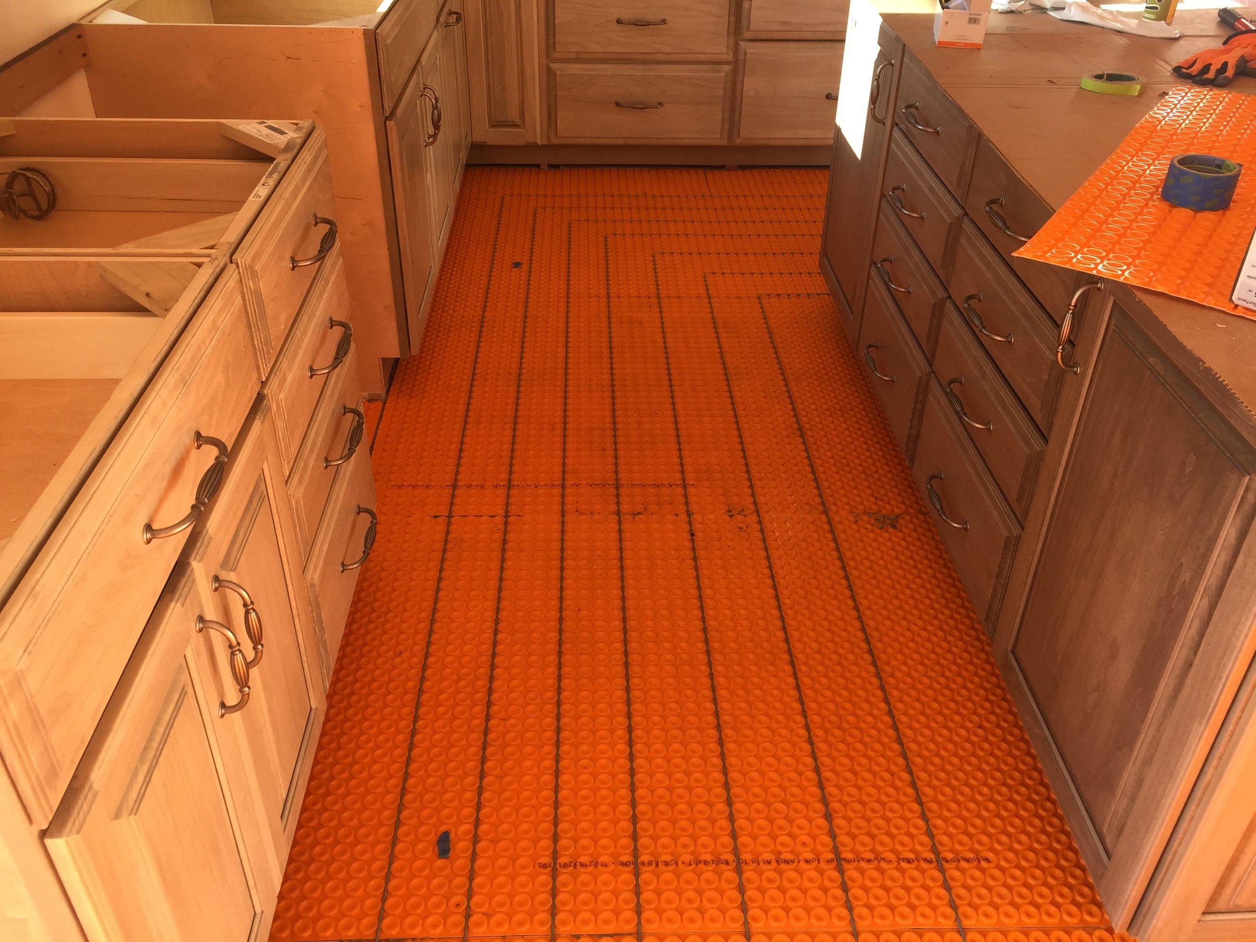 Underlayment for heated tile floors