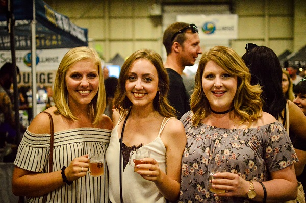 3 friends at beer show.jpg
