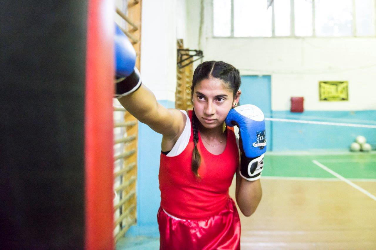 After winning several medals at regional competitions in Maldova, 16-year-old Stela now dreams of becoming an Olympic boxer. (Courtesy of UN Women Moldova)