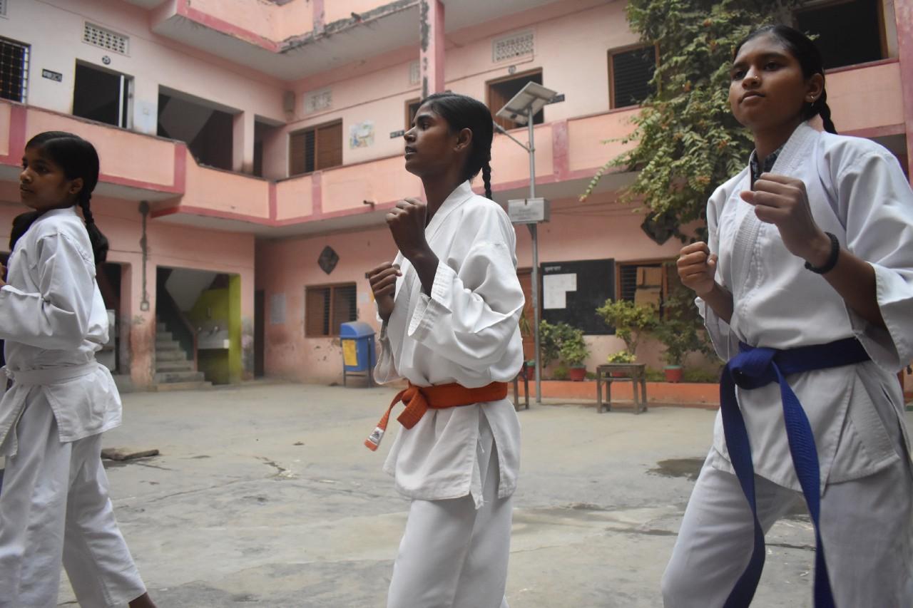 Some mornings, Rani practises karate with her schoolmates before class.(Courtesy of Bhumika Regmi / Malala Fund)