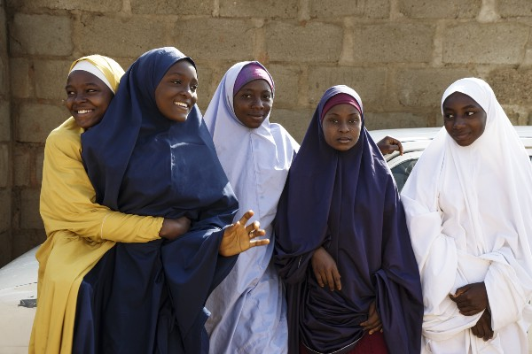 Amina and her friends in Nigeria. (Courtesy of HUMAN / Malala Fund)