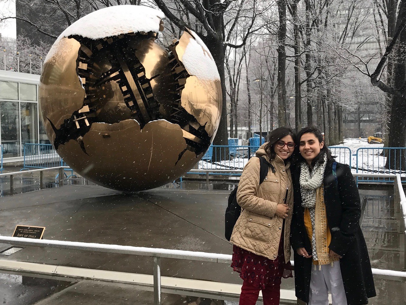 Noorena and Gulalai in front of the UN — it was their first time seeing snowfall! (Courtesy of Tess Thomas / Malala Fund)