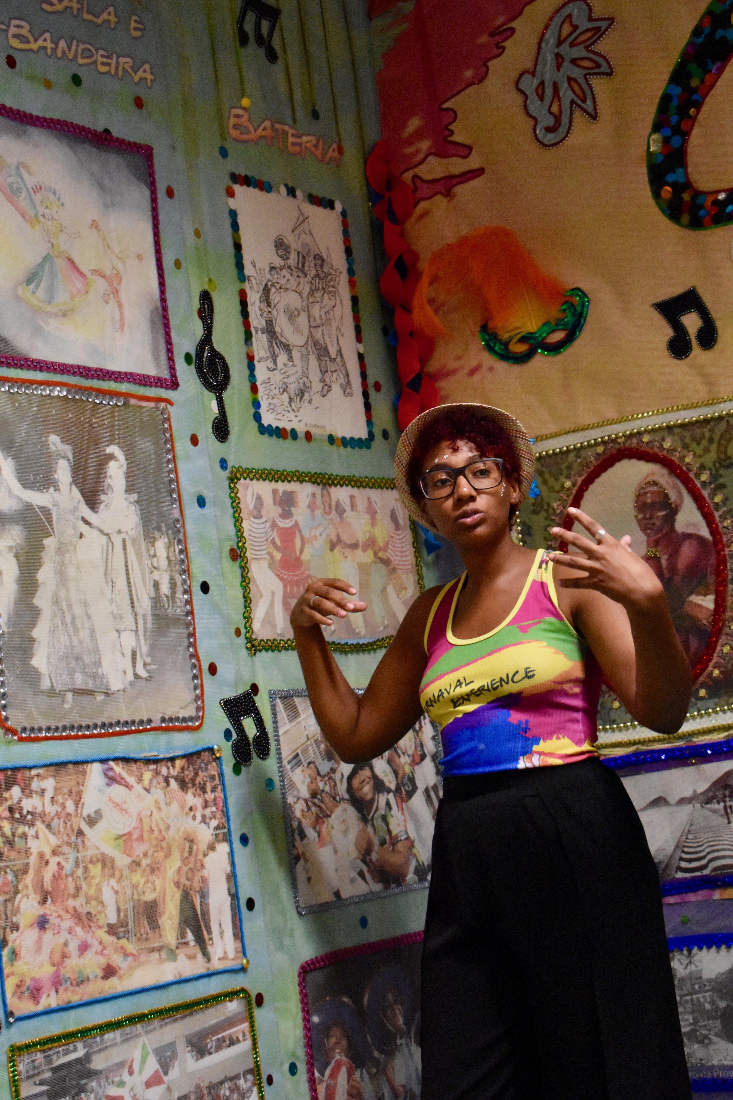 Dondara explaining the history of carnival during a tour of Grande Rio Samba School. (Courtesy of Tess Thomas / Malala Fund)