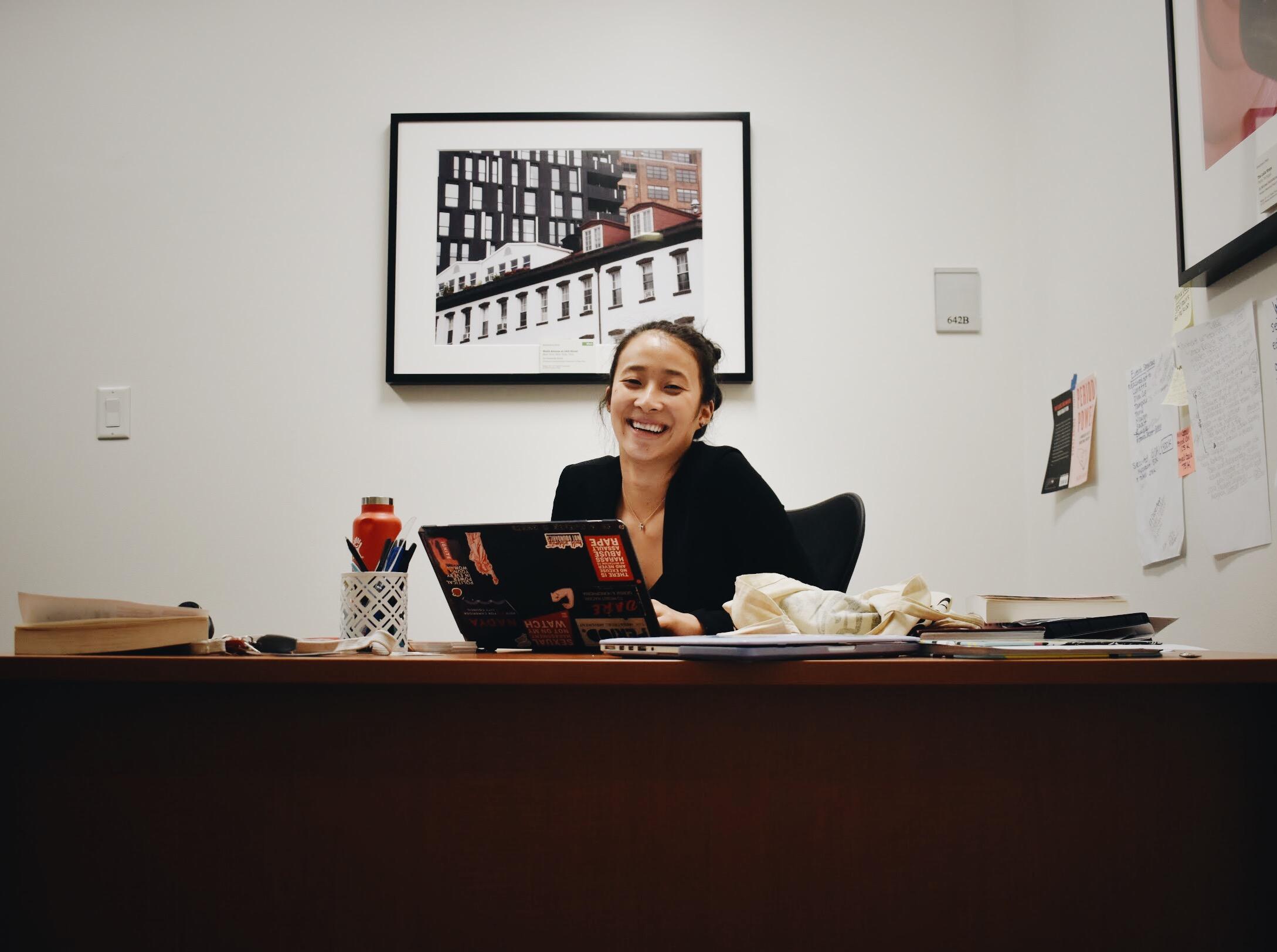 Nadya Okamoto at her desk in PERIOD's New York office. (Courtesy of McKinley Tretler / Malala Fund)