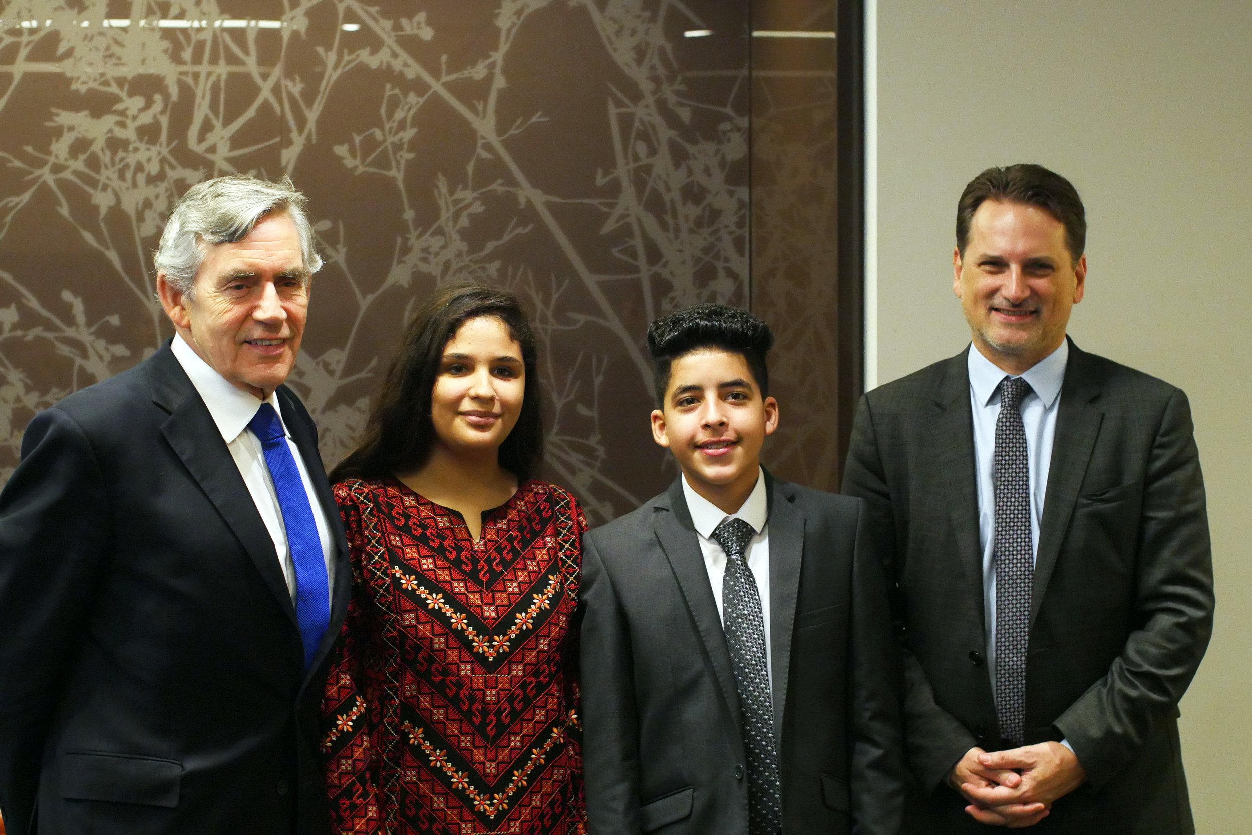 From left to right, former British Prime Minister Gordon Brown, Aseel, Ahmad and UNRWA Commissioner-General Pierre Krähenbühl. (Courtesy of Ozlem Eskiocak / UNRWA)