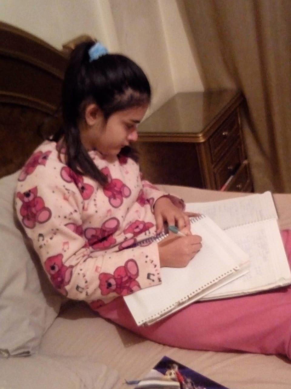 Working on my math homework. (Courtesy of Huda)