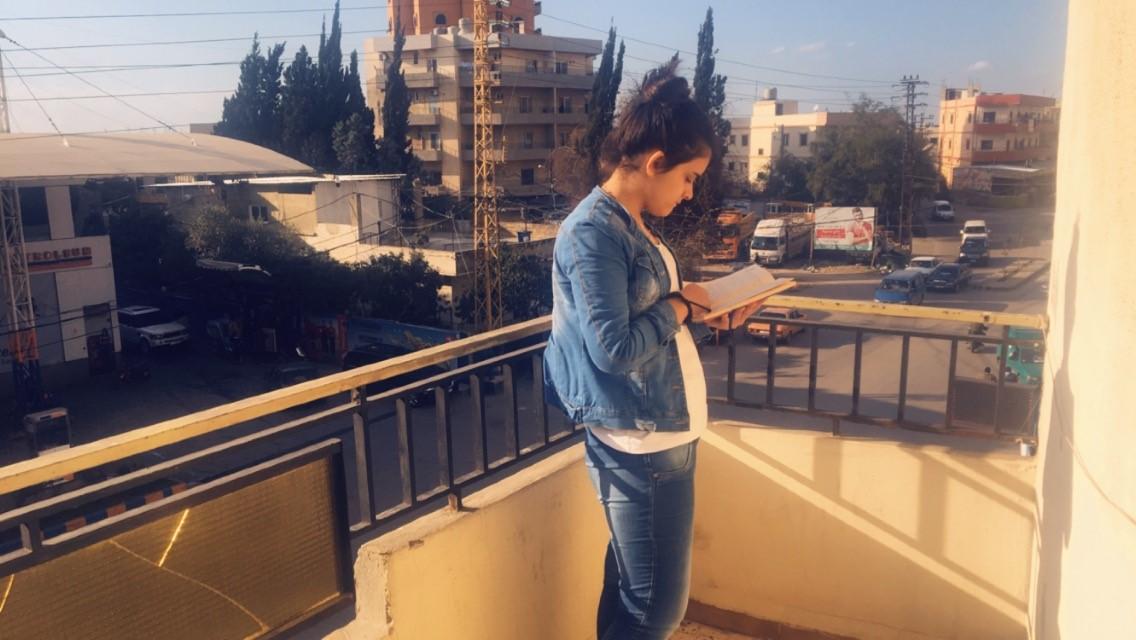 Reading at the Naba'a office. (Courtesy of Huda)