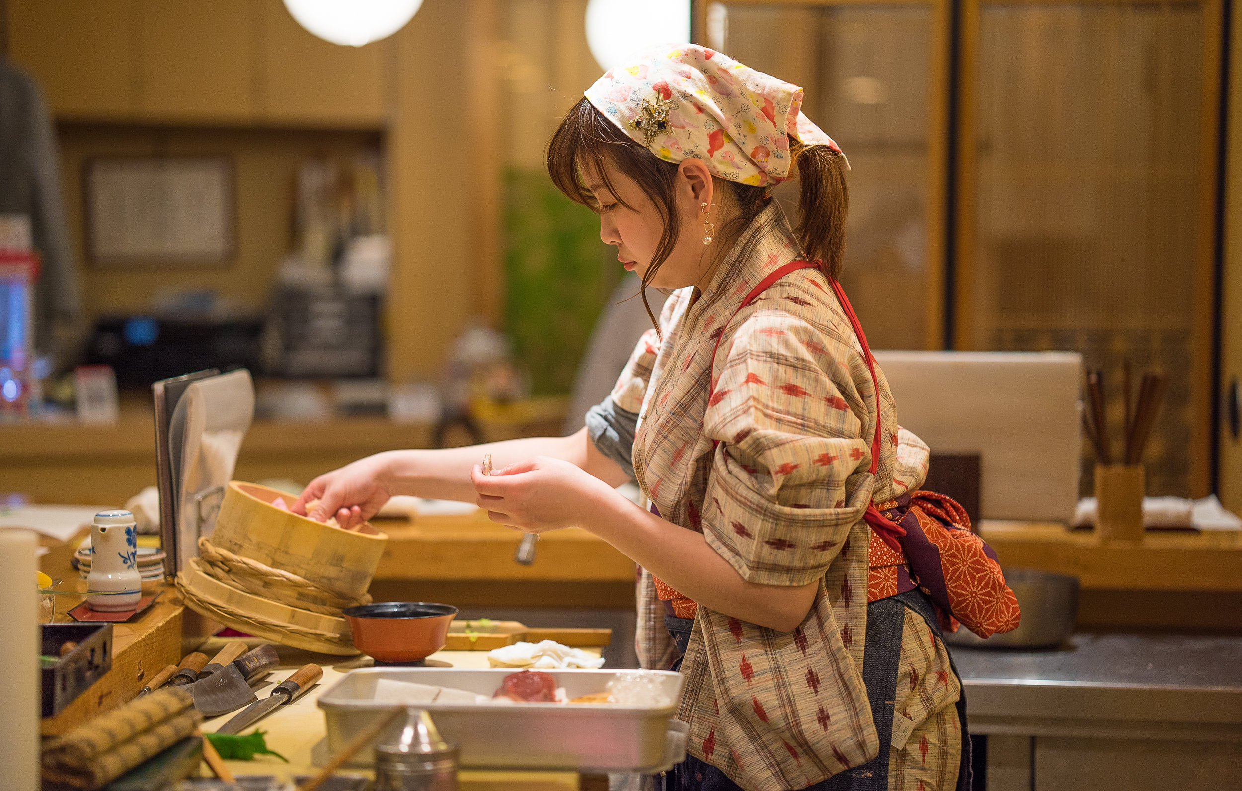 Yuki prepares rice for guests at Nadeshiko Sushi. (Courtesy of Amarachi Nwosu / Malala Fund)