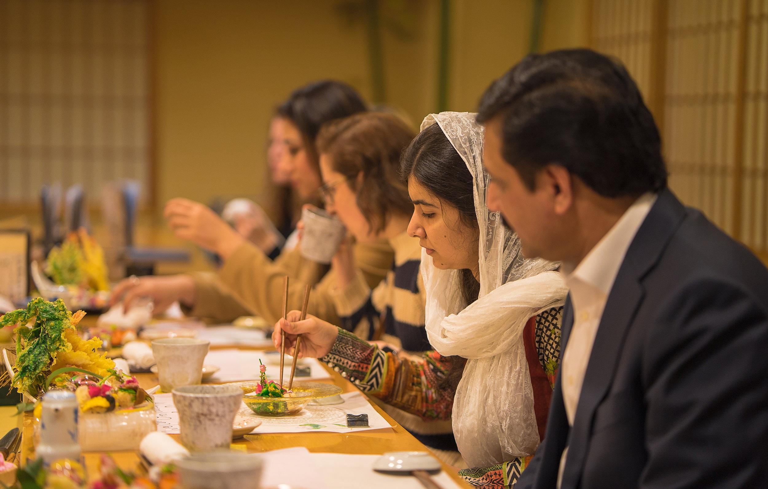 Malala and her father, Ziauddin, sampling dishes at Nadeshiko Sushi. (Courtesy of Amarachi Nwosu / Malala Fund)
