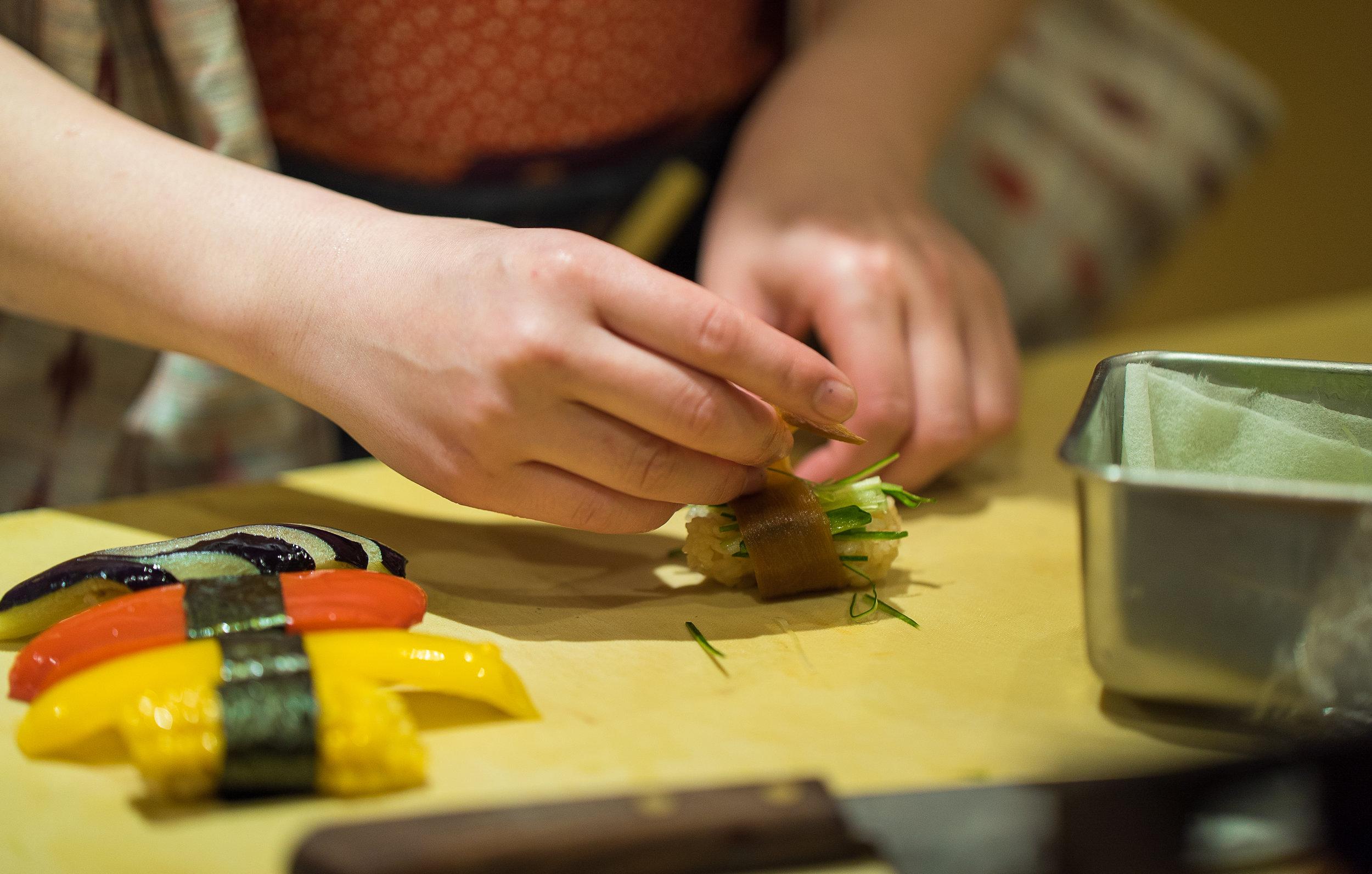 Yuki wraps vegetable sashimi. (Courtesy of Amarachi Nwosu / Malala Fund)