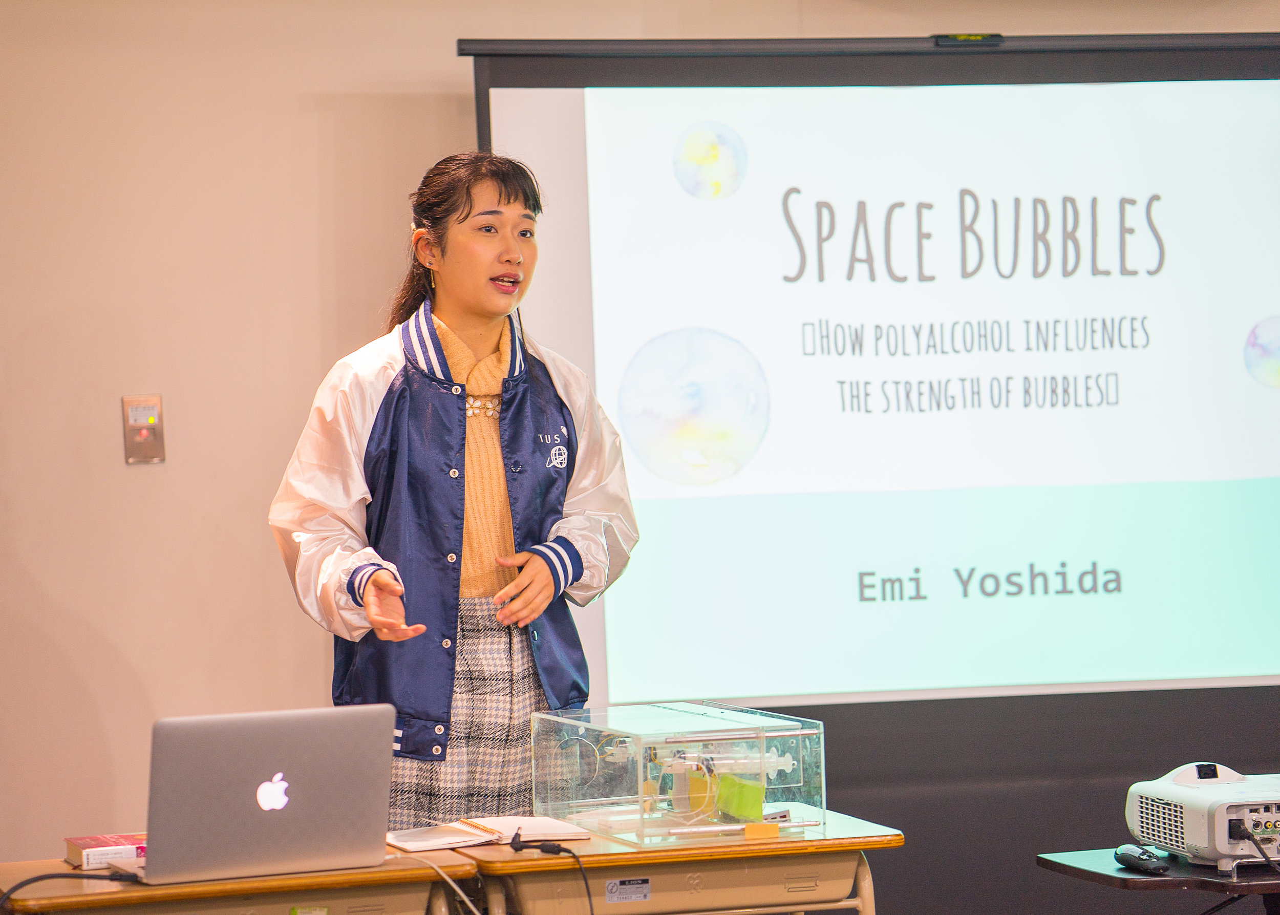 Emiko presents findings from her team's Space Bubbles experiment. (Courtesy of Amarachi Nwosu / Malala Fund)