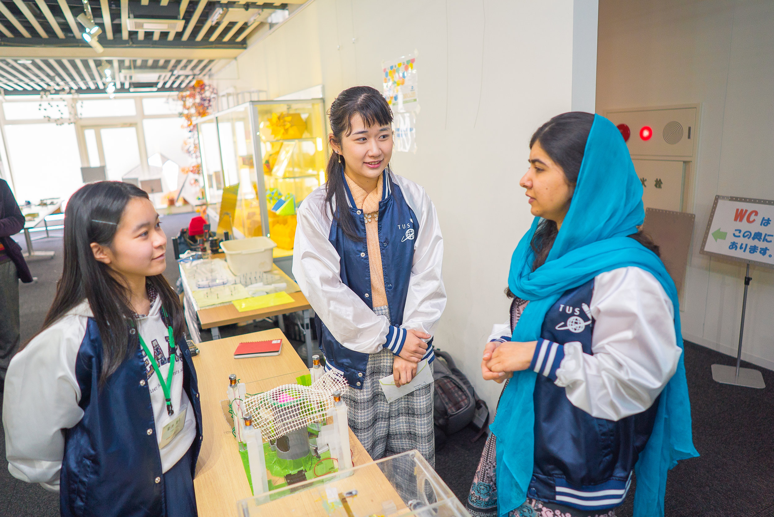Miki (far left) and Emiko (middle) show their devices to Malala when she visited Tokyo University of Science in March 2019. (Courtesy of Amarachi Nwosu / Malala Fund)