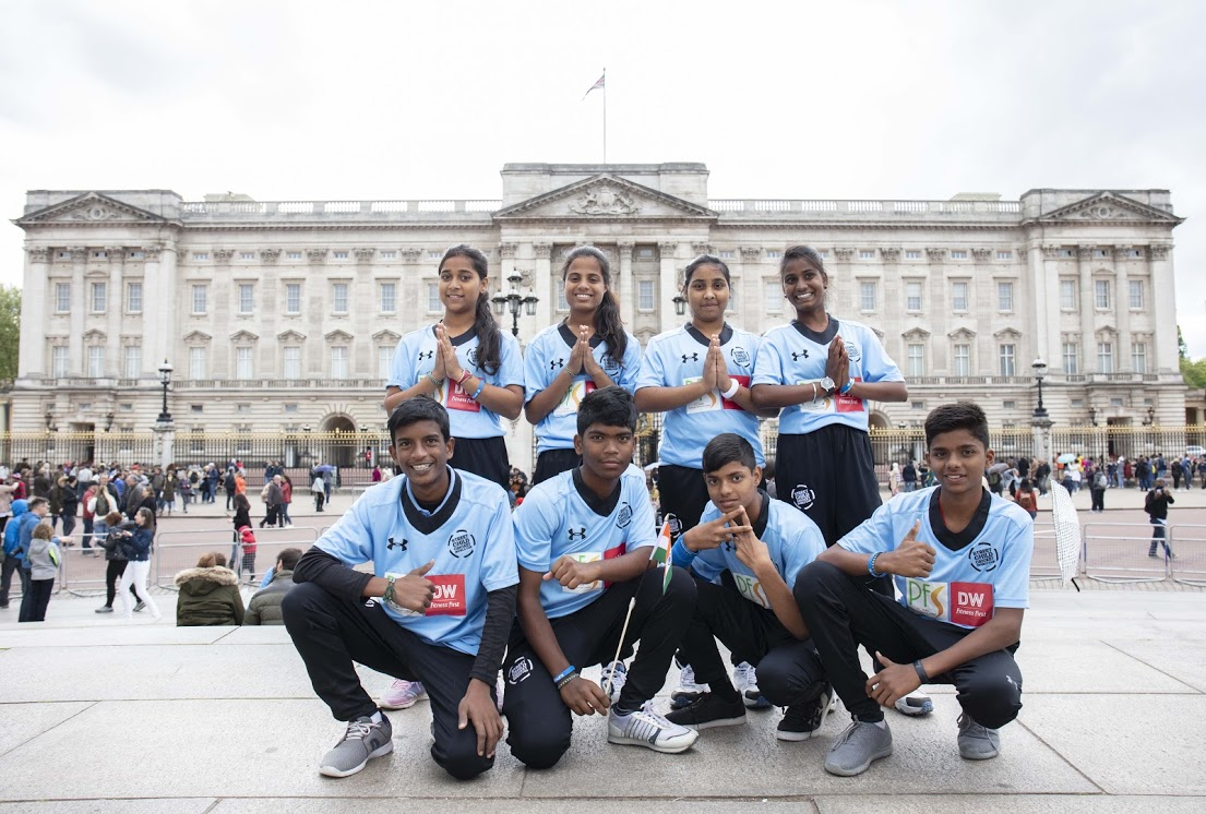 Lusi with her team in front of Buckingham Palace. (Courtesy of Rosie Hallam)