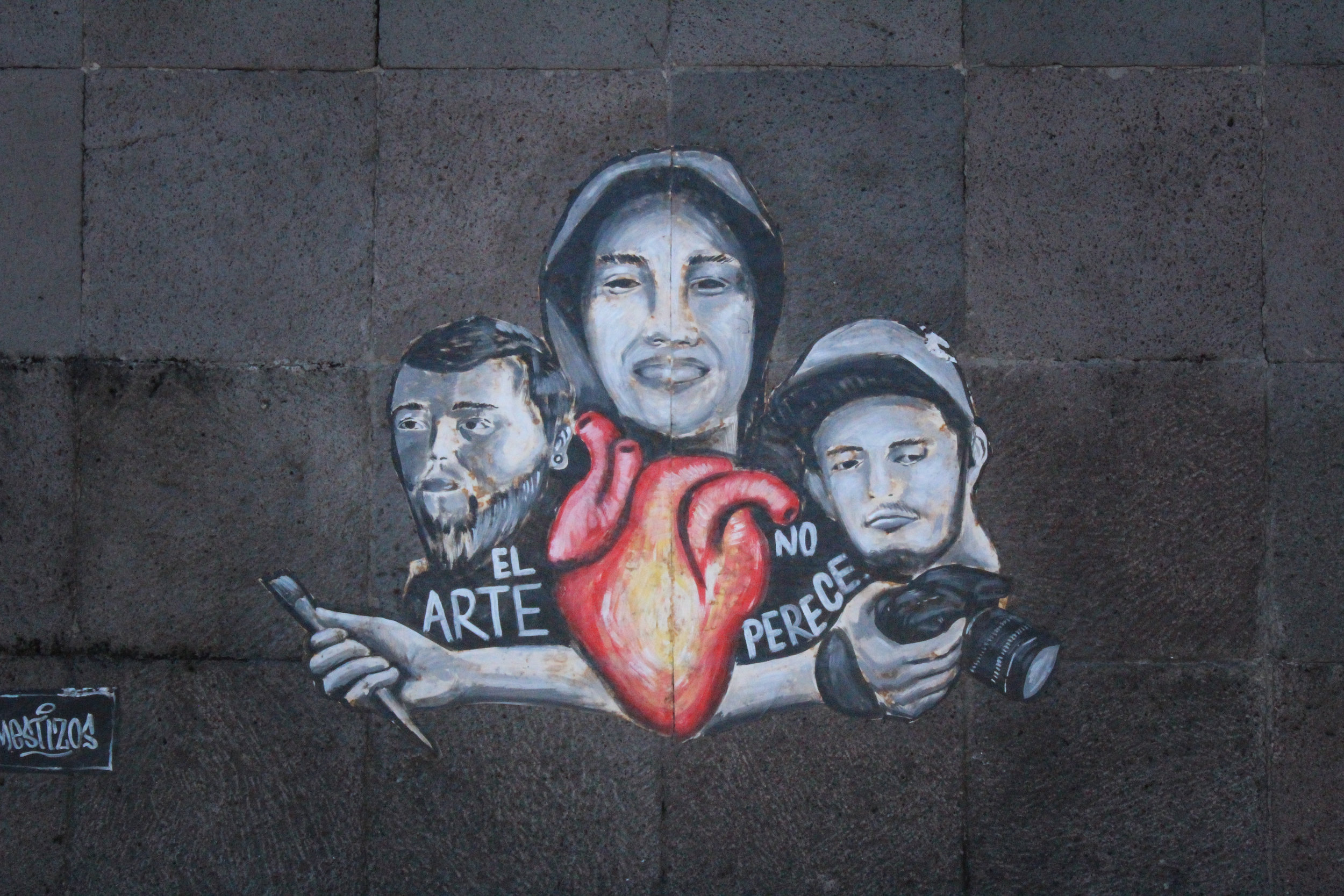 "This mural on a roundabout in Guadalajara depicts Javier, Marco and Jesús, the three film students that went missing. This place is now known as ""Glorieta de las y los desaparecidos,"" honoring all the missing people in Mexico. (Courtesy of Saraí López)"
