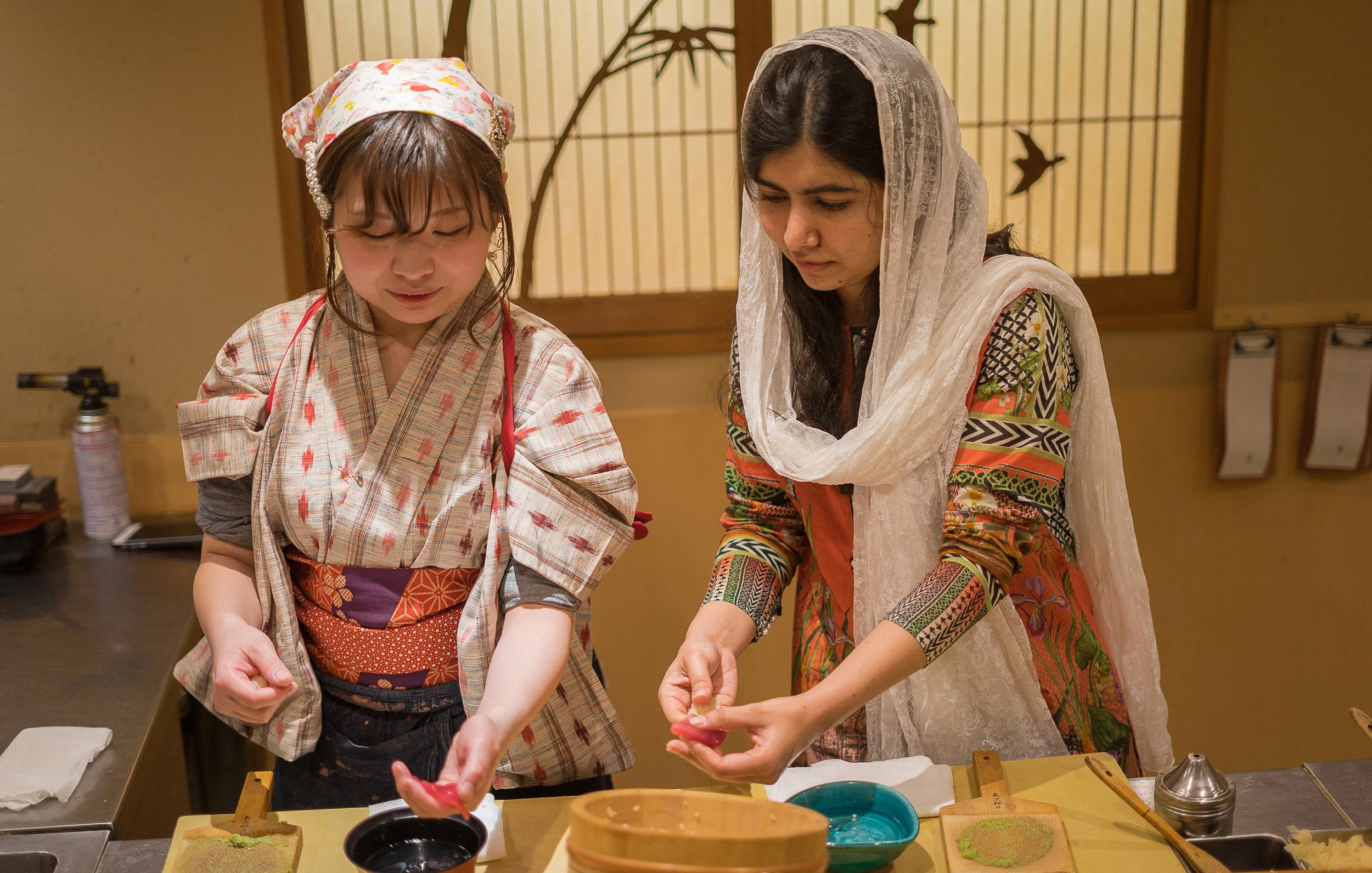 On her trip to Tokyo, Malala Yousafzai visited Yuki Chizui at her restaurant, Nadeshiko Sushi, to hear about her work to advance women in the industry. After sampling some dishes, Yuki taught Malala how to make sushi in the Japanese tradition. (Courtesy of Amarachi Nwosu / Malala Fund)