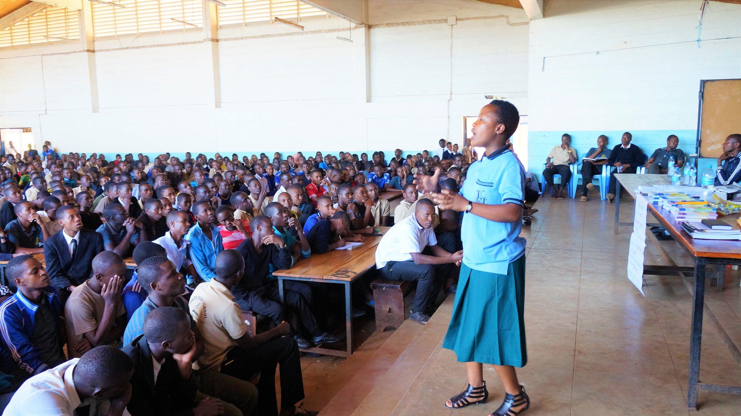 Melanie speaking about menstruation to 715 young men at Karatu High School. (Courtesy of Nano Chatfield / The Girls Foundation of Tanzania)