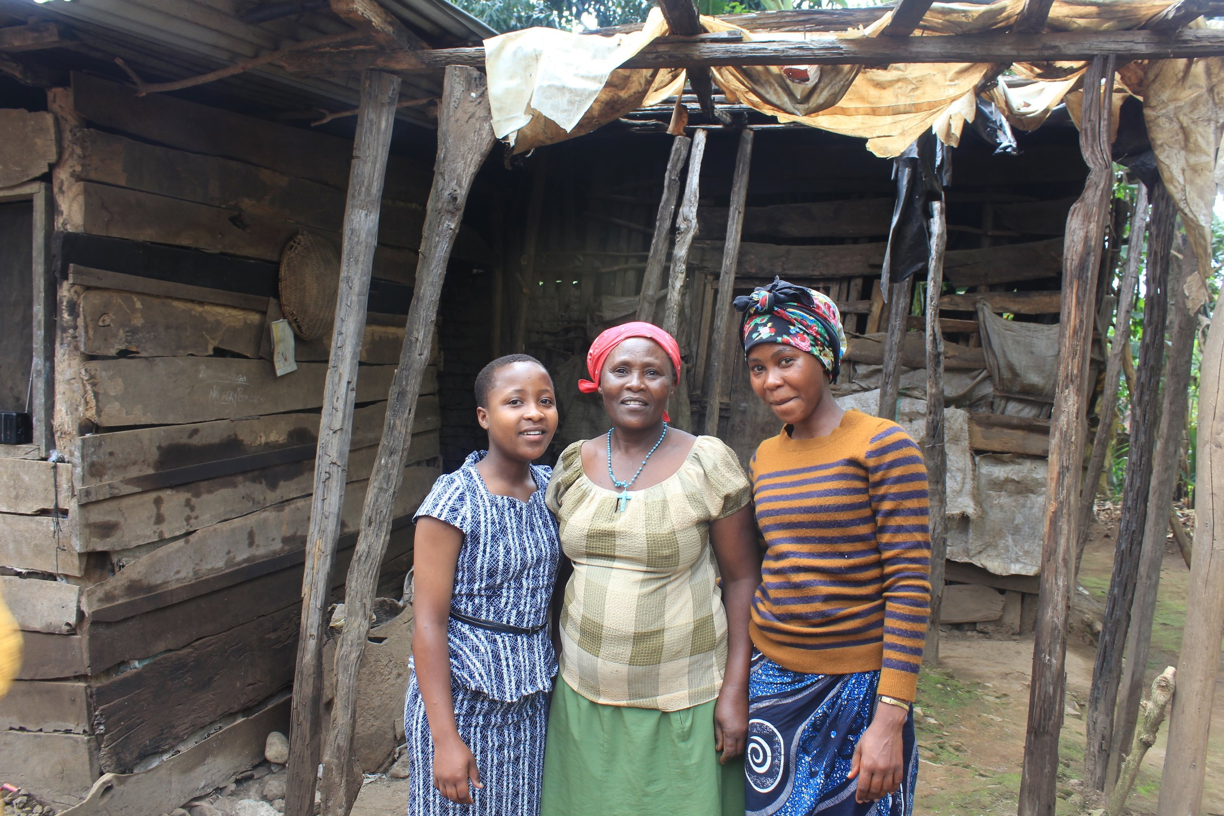 Melanie, her mom and her sister at at their home in Uru, Tanzania. (Courtesy of Nano Chatfield / The Girls Foundation of Tanzania)